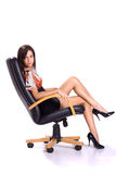 Sexy brunette in mini seat on armchair Royalty Free Stock Photos