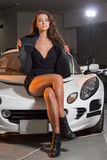 brunette model in garage Royalty Free Stock Image