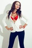 brunette model posing over white wall Royalty Free Stock Photo