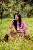 brunette near a basket of apples Royalty Free Stock Photos