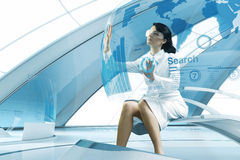 brunette operating transparent future touch i stock photos