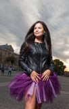 brunette outdoors weared black leather jacket Royalty Free Stock Photos