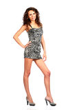 Sexy brunette in  parti-coloured dress Royalty Free Stock Photography