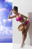 Pretty brunette with bikini folded forward Royalty Free Stock Image