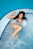 Sexy brunette in a pool Royalty Free Stock Photo