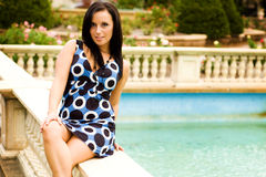 brunette by the pool Royalty Free Stock Photography