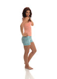 Brunette Portrait. Brunette Posing with Pink Shirt & Baby Blue Jeans Shorts royalty free stock images