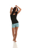 Brunette Portrait. Brunette Posing with Black Top & Blue Shorts royalty free stock photos