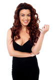 Sexy brunette posing in black party wear attire. Isolated against white background Stock Images