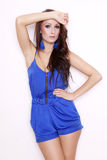 Sexy brunette posing in blue dress. Stock Photo