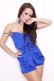 Sexy brunette posing in blue dress. Stock Photo