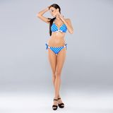 brunette posing in blue swimsuit Stock Photos