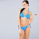 brunette posing in blue swimsuit Royalty Free Stock Photos