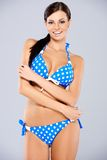 Sexy brunette posing in blue swimsuit Stock Image