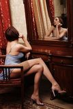 brunette posing next to the mirror Royalty Free Stock Images