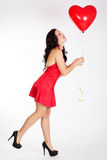 Sexy brunette with red ballon Stock Image