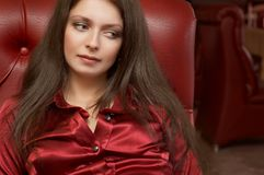 Sexy brunette in red colors Stock Photos