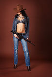 Sexy brunette with a rifle Royalty Free Stock Photos