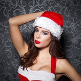 Sexy brunette santa woman posing Royalty Free Stock Images