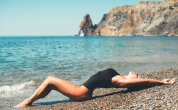 Sexy brunette on a seashore Stock Images