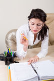 Sexy brunette secretary in office. Attractive brunette secretary on working place Royalty Free Stock Image