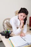 Sexy brunette secretary in office. Attractive brunette secretary on working place Stock Image