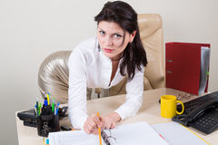 Sexy brunette secretary in office. Attractive brunette secretary on working place Stock Photo
