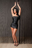Sexy brunette in short black dress Royalty Free Stock Photo