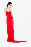 Sexy brunette in a slinky bright red evening dress Stock Image
