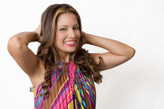 Attractive Brunette. An attractive brunette stroking her hair royalty free stock image