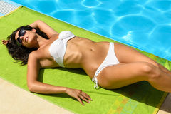 Sexy brunette sunbathing Stock Photos