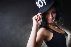 Brunette. Swag girl. Portrait of brunette in cap royalty free stock photo
