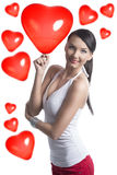 Sexy brunette takes the heart shaped balloon Royalty Free Stock Photos