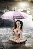 Sexy brunette with umbrella, s Royalty Free Stock Image
