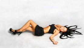 brunette undressing Royalty Free Stock Image