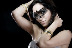 Brunette with venetian mask. sensuality concept Royalty Free Stock Photos