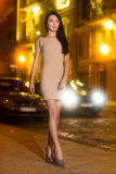 Sexy brunette wearing beige dress Stock Photos