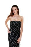 Sexy brunette wearing a black and silver dress Royalty Free Stock Photo