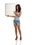 Brunette with White Billboard. Brunette with empty white billboard in hands stock photo