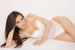 Sexy brunette with white lingerie Royalty Free Stock Photography