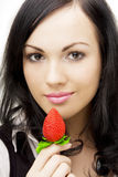Sexy brunette, who eats strawberries Stock Photo