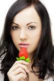 Sexy brunette, who eats strawberries Stock Photography