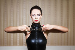 Sexy brunette woman bdsm Royalty Free Stock Image