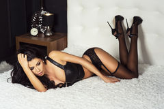 Sexy brunette woman in bed Stock Photos