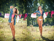 Sexy brunette woman in bikini and shirt putting clothes to dry in sun. Sensual young female with long legs putting out the washing Royalty Free Stock Images