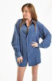 Sexy Brunette woman in blue men's shirt Stock Image