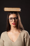 Sexy brunette woman with book on head Royalty Free Stock Photography