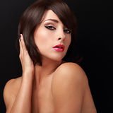 Sexy brunette woman with bright makeup, red lips and short hair style looking Royalty Free Stock Photos