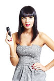 brunette woman with a cell phone Stock Photography