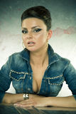 Sexy brunette woman in denim jacket Stock Images